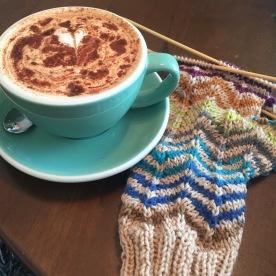 Knitted fingerless mitt.